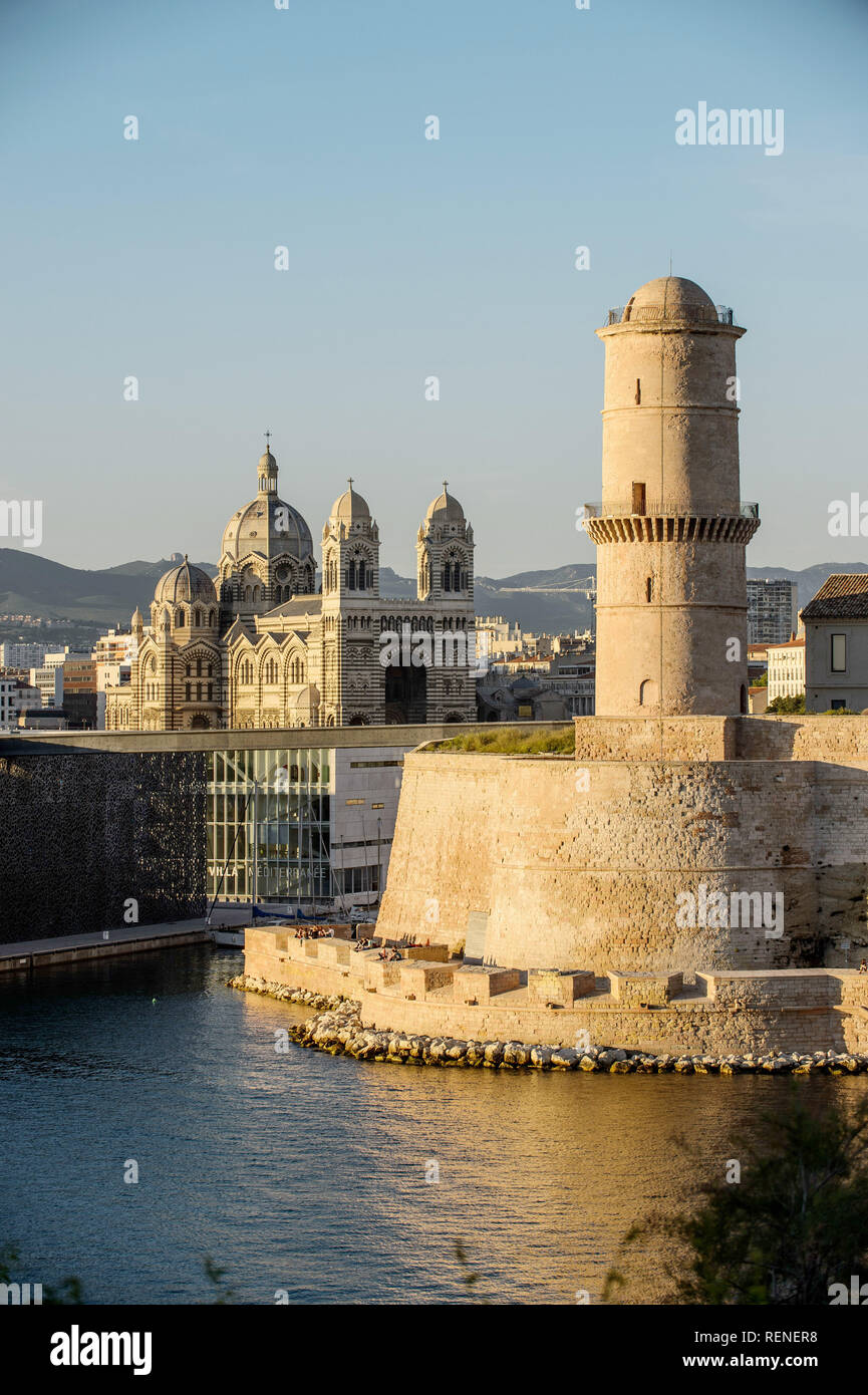 Marseille (south-eastern France): Fort Saint-Jean, the MuCem and Marseille Cathedral at the entrance to the Old Harbour, at sunset *** Local Caption * - Stock Image