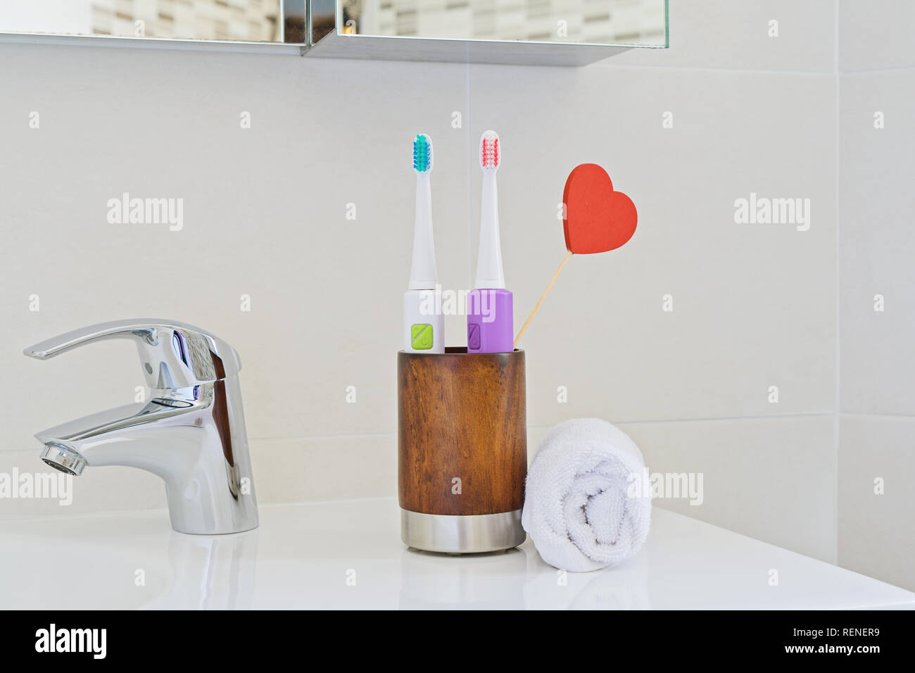 Stupendous Two Electric Toothbrushes In Wooden Glass On Sink In Interior Design Ideas Gentotthenellocom