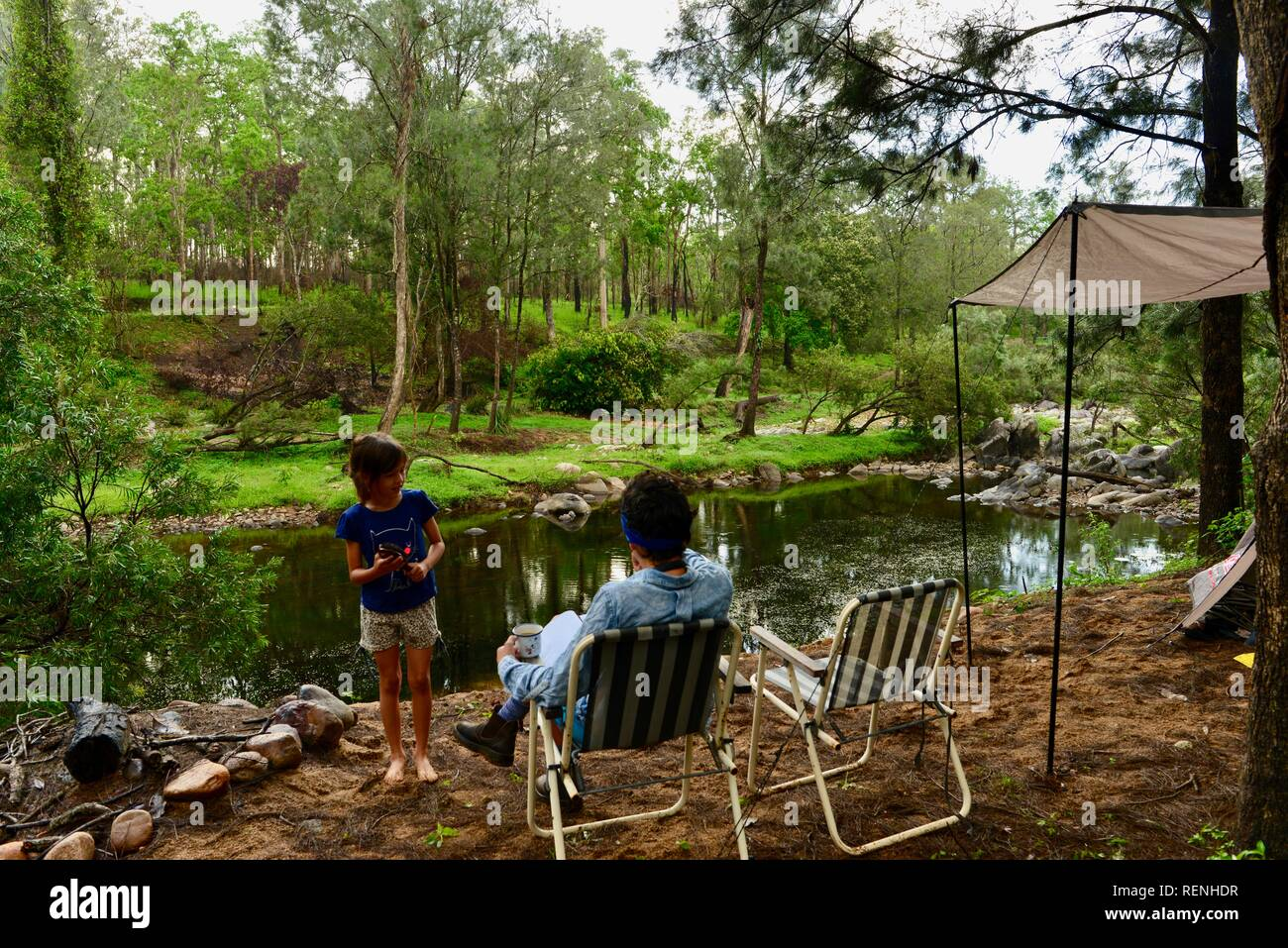 Camping next to Teemburra Creek at Captain's crossing, Mia Mia State Forest, Queensland, Australia Stock Photo