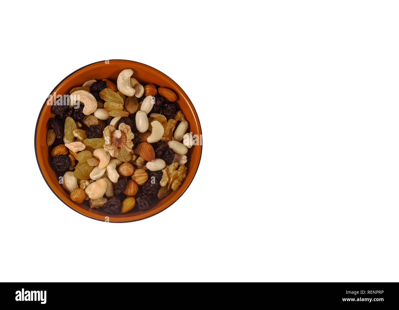 Mixture of nuts and dried fruits on an isolated white background. top view. - Stock Image