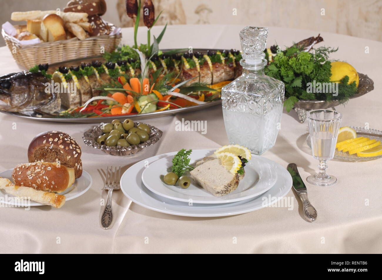 Table served with stuffed pike, vodka, moonshine in a restaurant - Stock Image