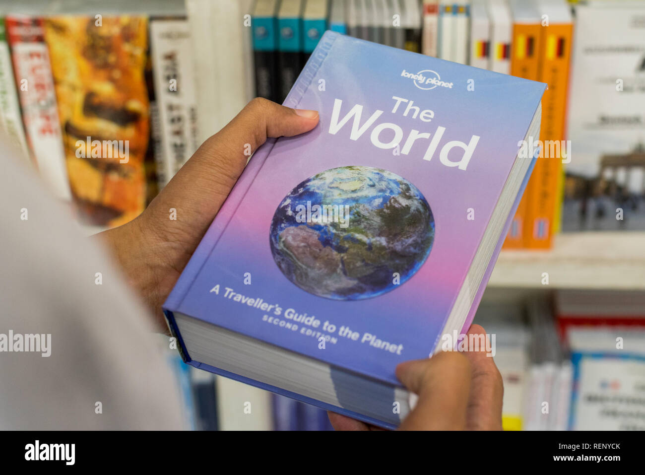 Bangkok, Thailand - July 21, 2018: Lonely Planet guidebook The World, A Traveller's Guide to the Planet, Second Edition. - Stock Image