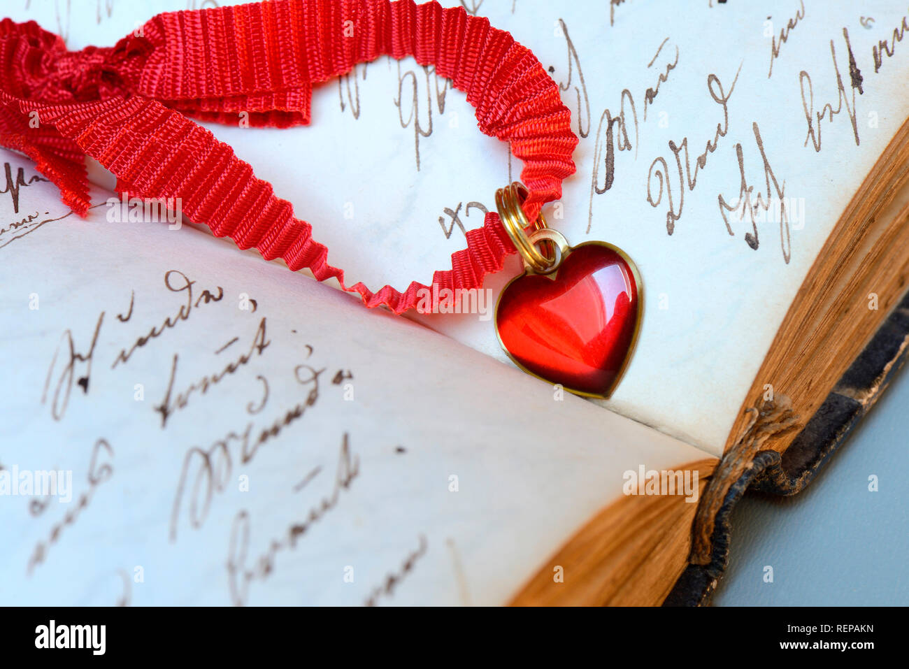 Heart on old book - Stock Image