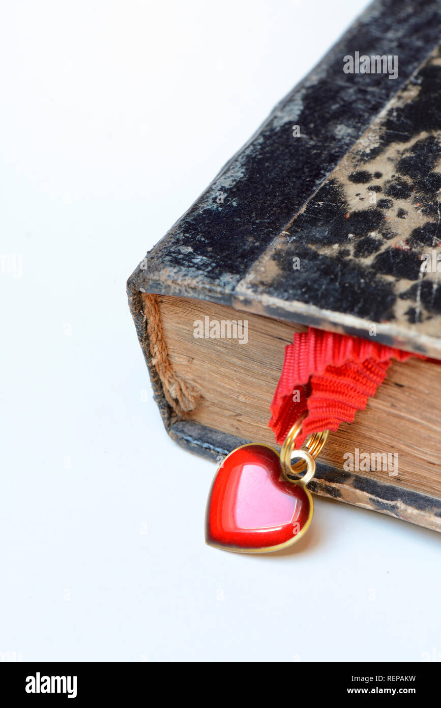 Heart in old book - Stock Image