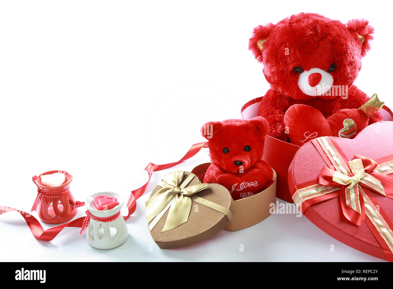 2c9b464e Valentine's Day concept. Red teddy bear in heart shaped gift box ...