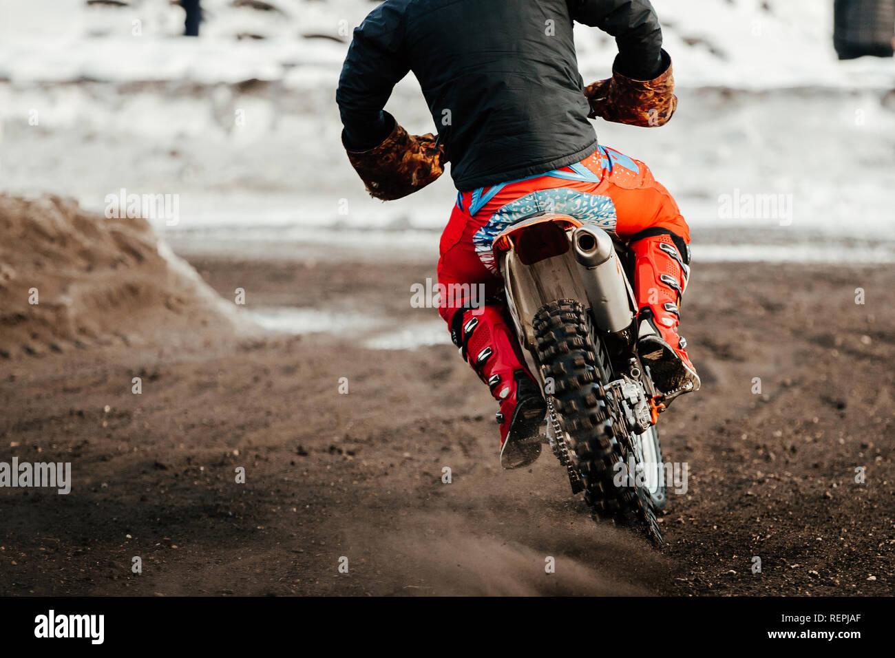 racer enduro motorcycle riding on winter track Stock Photo
