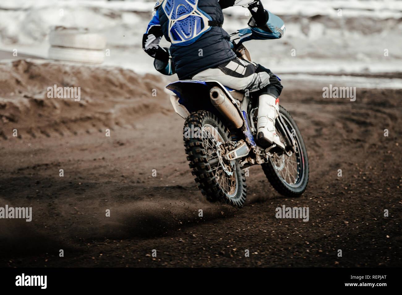 rider enduro motorbike riding on winter track Stock Photo
