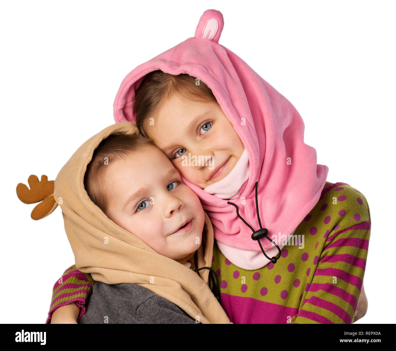 Boy and girl in warm carnival hats Stock Photo
