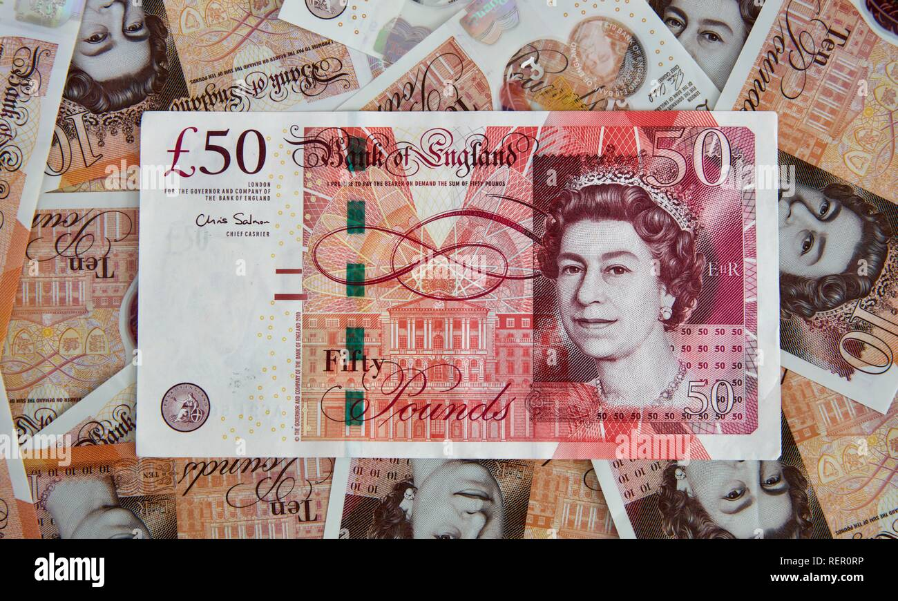 Bank of England £50 note with the new polymer £10 banknotes in the background - Stock Image