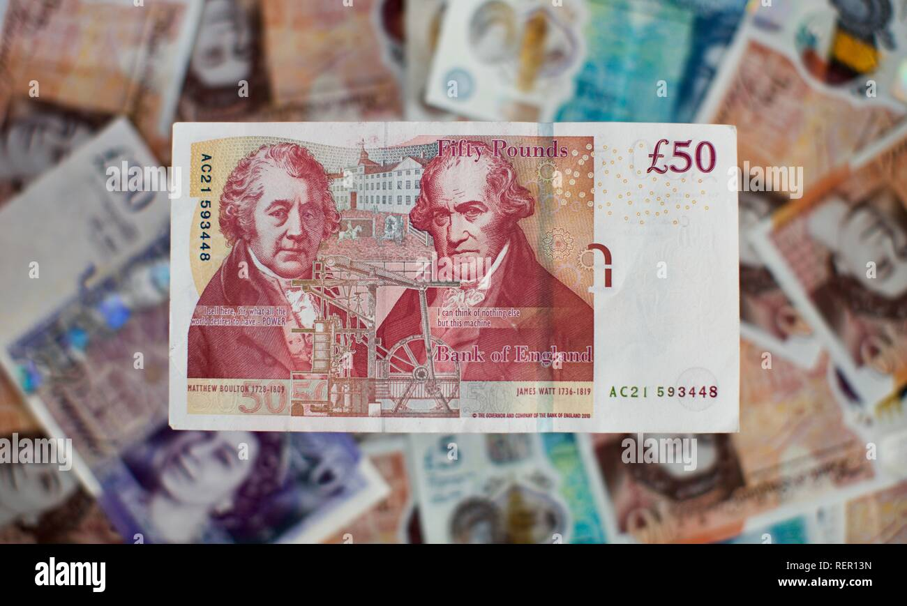 Bank of England £50 note with current £5, £10 and £20 banknotes in the background - Stock Image