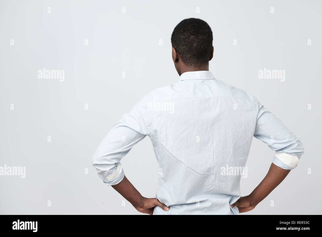 African american guy, in white shirt, turning back to the camera as he is offended. Stock Photo