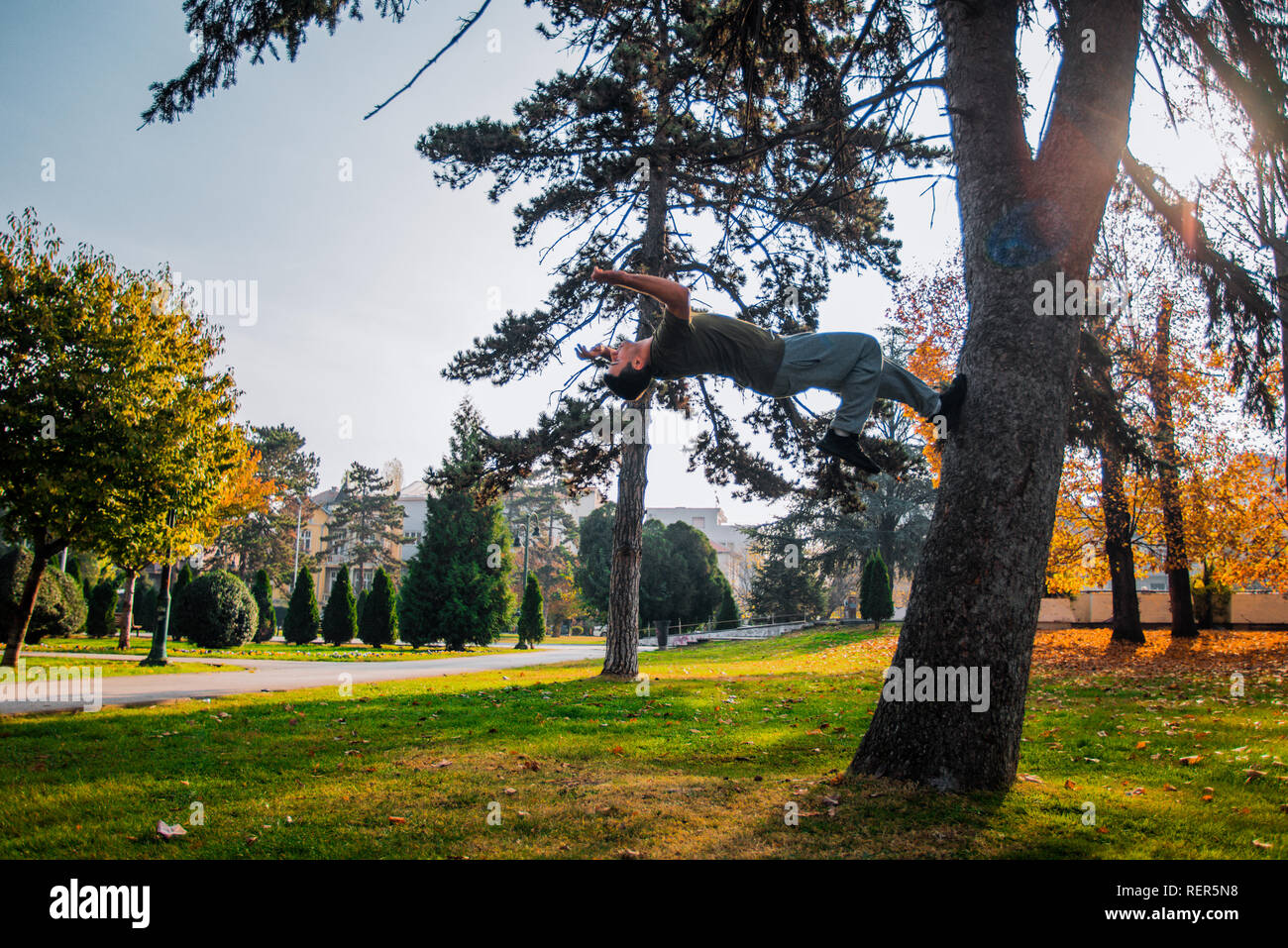Training day of young traceur while doing parkour jumping - Stock Image