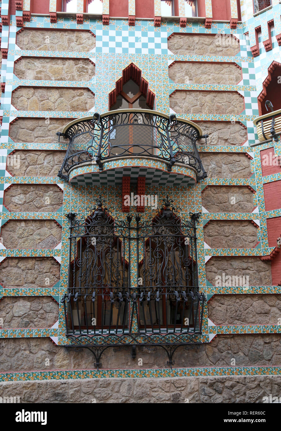 Casa Vicens, built from 1883 to 1885. First project of the architect Gaudí. Balcony and windows, street facade. Decorative iron gratings. Stock Photo