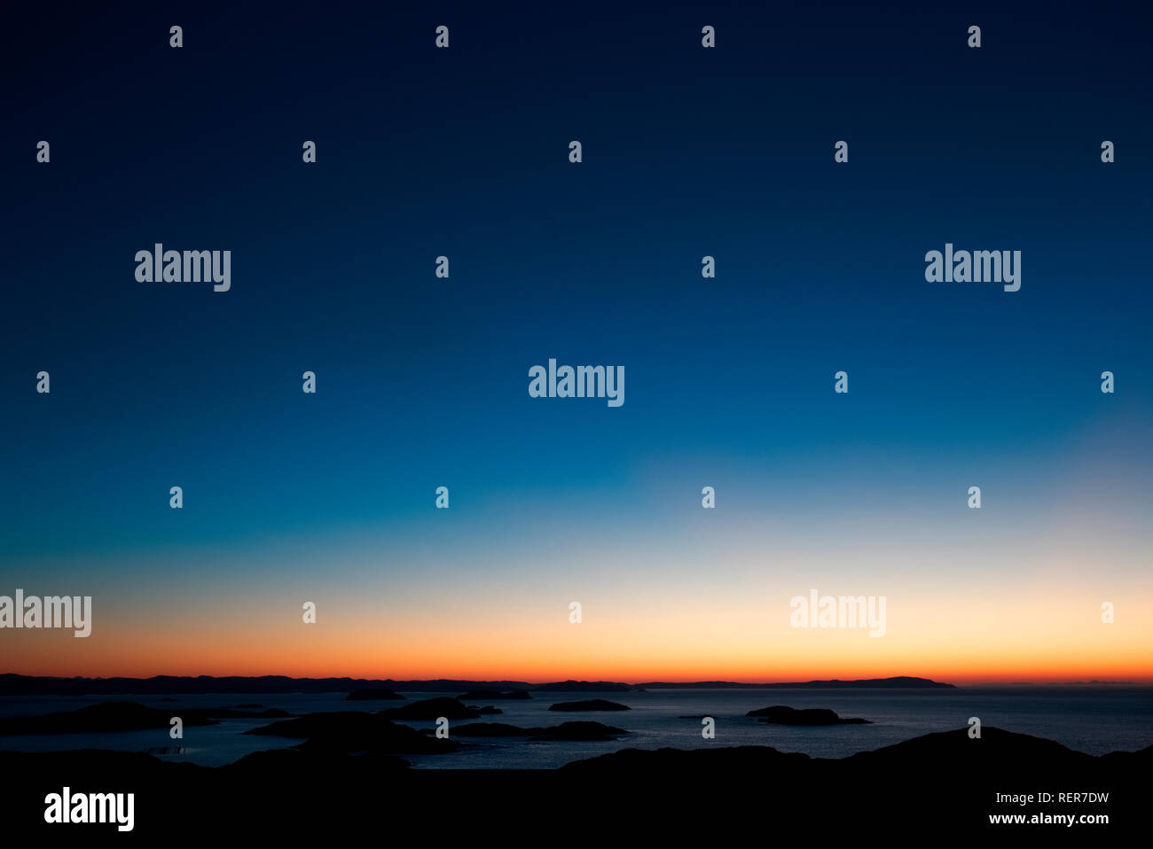 Dusk with a clear sky at Badcall Bay, Sutherland - Stock Image