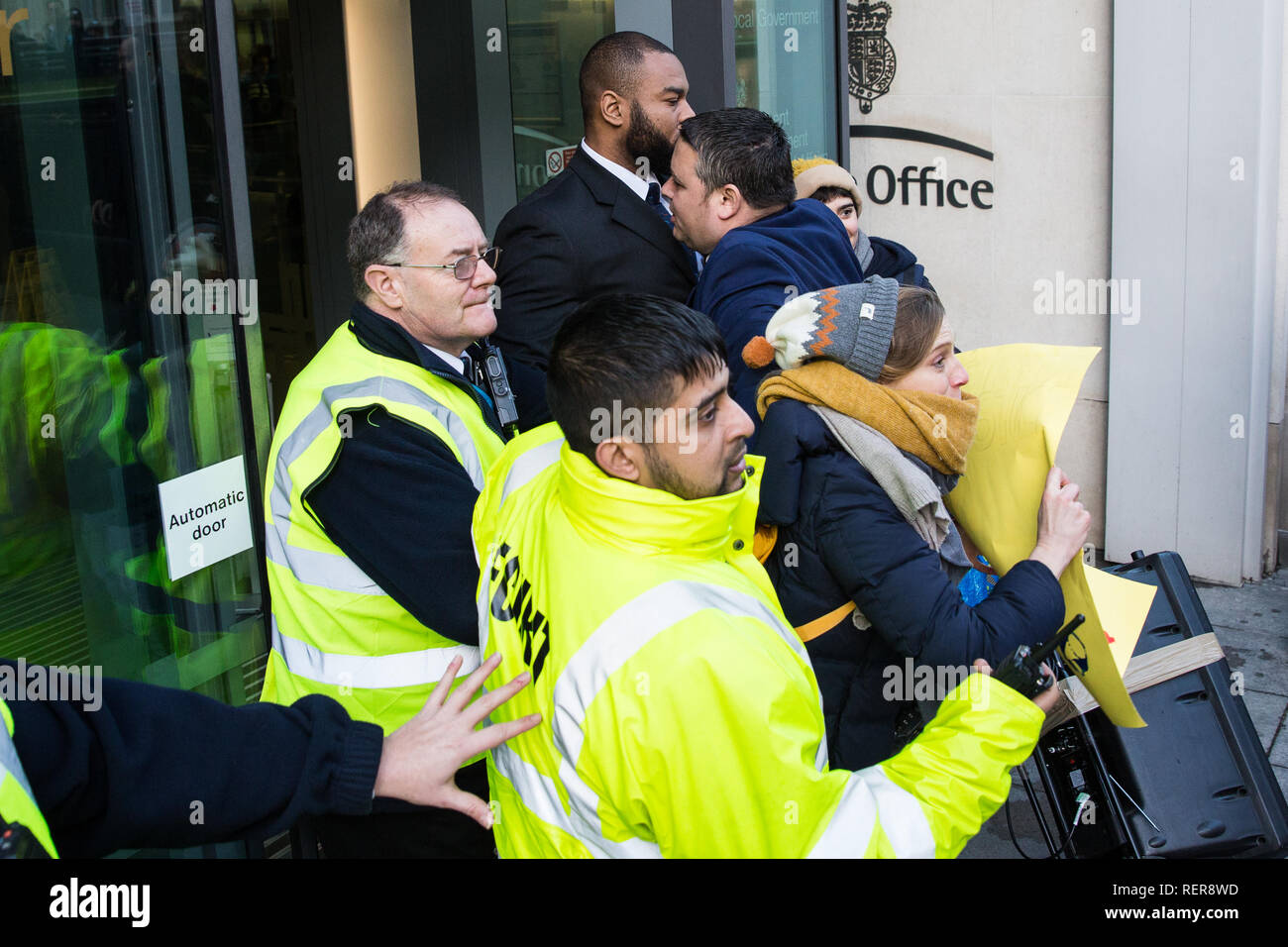 London, UK. 22nd Jan, 2019. Members of the United Voices of the World (UVW) trade union representing receptionists, security guards and cleaners at the Ministry of Justice (MoJ) try to storm the entrance of the Home Office after beginning a coordinated strike for the London Living Wage of £10.55 per hour and parity of sick pay and annual leave allowance with civil servants. The strike is being coordinated with support staff at the Department for Business, Energy and Industrial Strategy (BEIS) from the Public and Commercial Services (PCS) union. Credit: Mark Kerrison/Alamy Live News Stock Photo