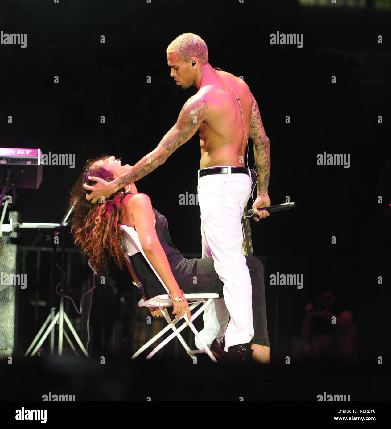 MIAMI, FL - MAY 28:  Chris Brown makes one fans day as he sticks his tounge in her mouth and bites her as he performs at the 5th anniversary of the Best Of The Best 'Spring Fest ' concert at at Bicentennial Park, Produced by South Florida's premier music and lifestyle promotions companies, Rocker's Island and XO Management. Christopher Maurice 'Chris' Brown (born May 5, 1989) is an American R&B singer, songwriter, dancer, and actor. on May 28, 2011 in Miami,  Florida.  People:   Chris Brown - Stock Image