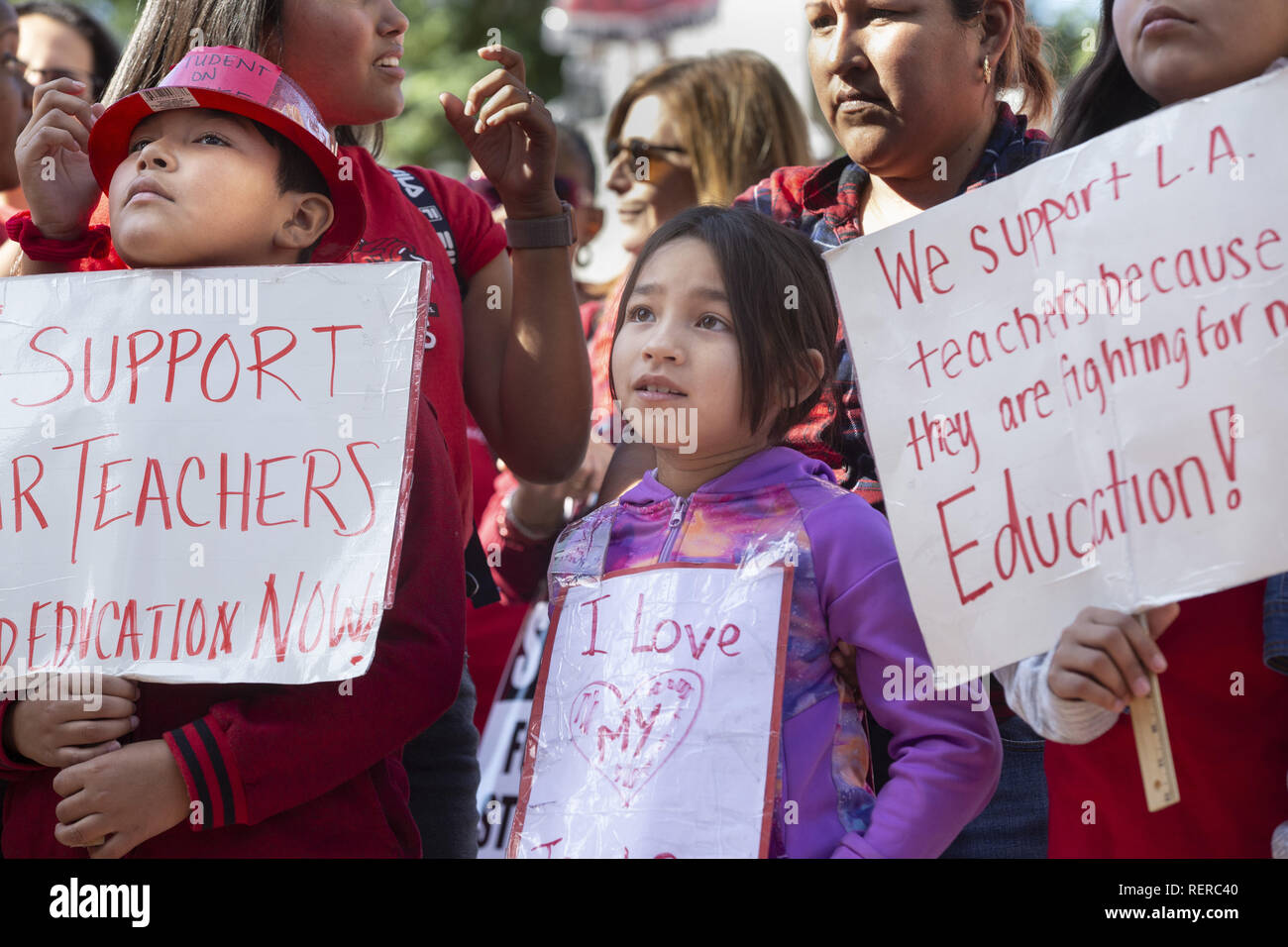 Los Angeles, California, USA. 22nd Jan, 2019. Priscilla, a 2nd grade student at Marlton School for deaf and hard of hearing students, watches speakers at a downtown Los Angeles rally after an agreement between UTLA and the LAUSD was reached Tuesday, January 22, 2019. Credit: Allison Zaucha/ZUMA Wire/Alamy Live News - Stock Image