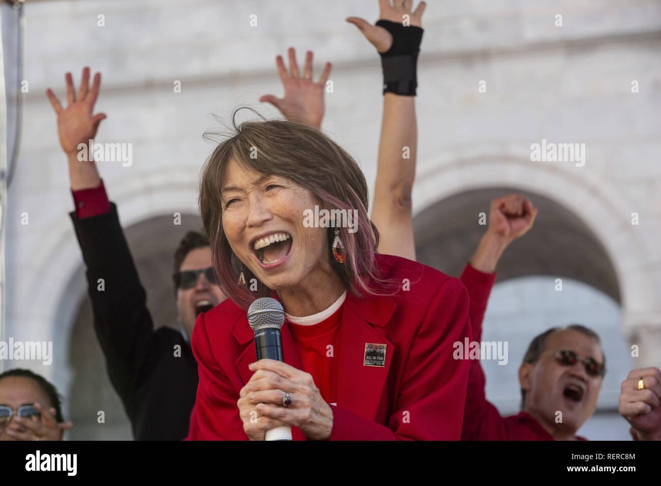 Los Angeles, California, USA. 22nd Jan, 2019. ARLENE INOUYE, Secretary at UTLA, speaks to the crowd at a downtown Los Angeles rally at city hall Tuesday, celebrating the announcement of an agreement to end the LAUSD teachers strike at a downtown LA rally at city hall. Credit: Allison Zaucha/ZUMA Wire/Alamy Live News - Stock Image