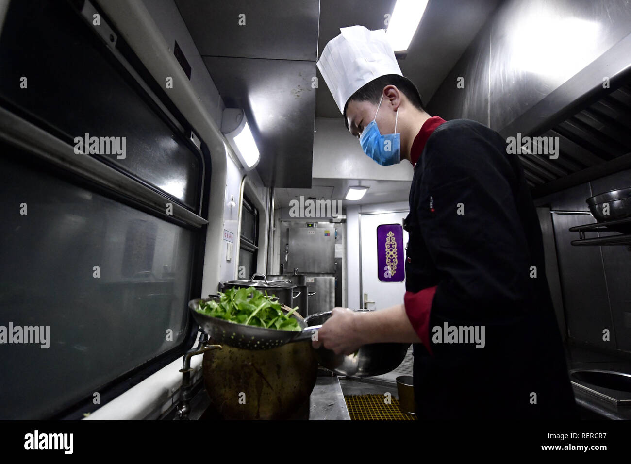Beijing, China. 21st Jan, 2019. A cook prepares pot-planted vegetable aboard the 'Tangzhugudao' theme train which runs from Xining to Xigaze on the Qinghai-Tibet Railway, on Jan. 21, 2019. Credit: Zhang Long/Xinhua/Alamy Live News - Stock Image