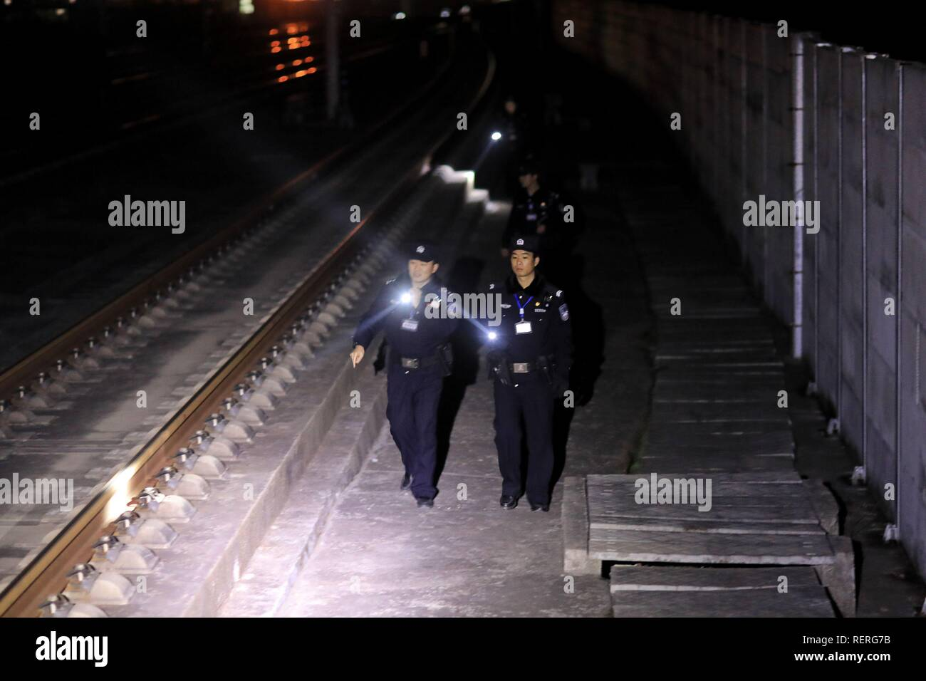 (190123) -- RONGJIANG, Jan. 23, 2019 (Xinhua) -- Police officers patrol on Guiyang-Guangzhou High-speed Railway, Jan. 22, 2019. Rongjiang Railway Police Station conducts two or three safety inspections at night every week during the Spring Festival travel rush. (Xinhua/Ou Dongqu) - Stock Image