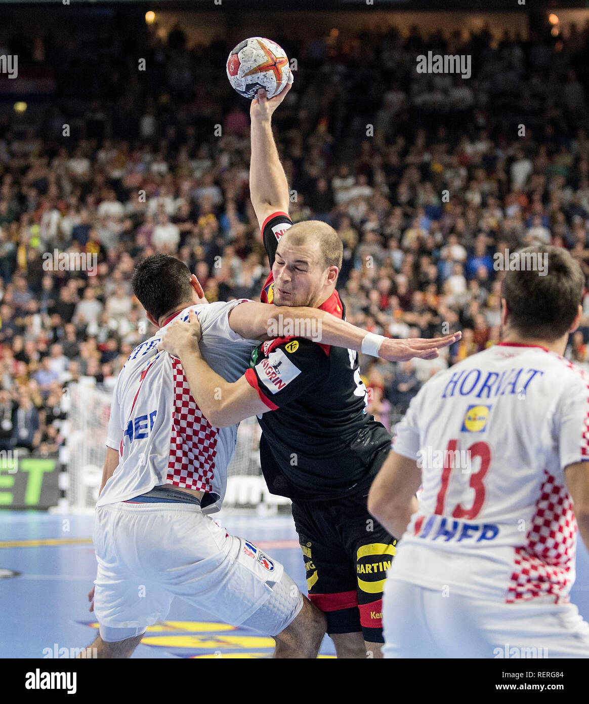 Paul DRUX (GER) in a duel versus Luka STEPANCIC l. (CRO) and Zlatko HORVAT r. (CRO), Main Round Group I, Croatia (CRO) - Germany (GER), on 21.01.2019 in Koeln / Germany. Handball World Cup 2019, from 10.01. - 27.01.2019 in Germany / Denmark. | usage worldwide Stock Photo