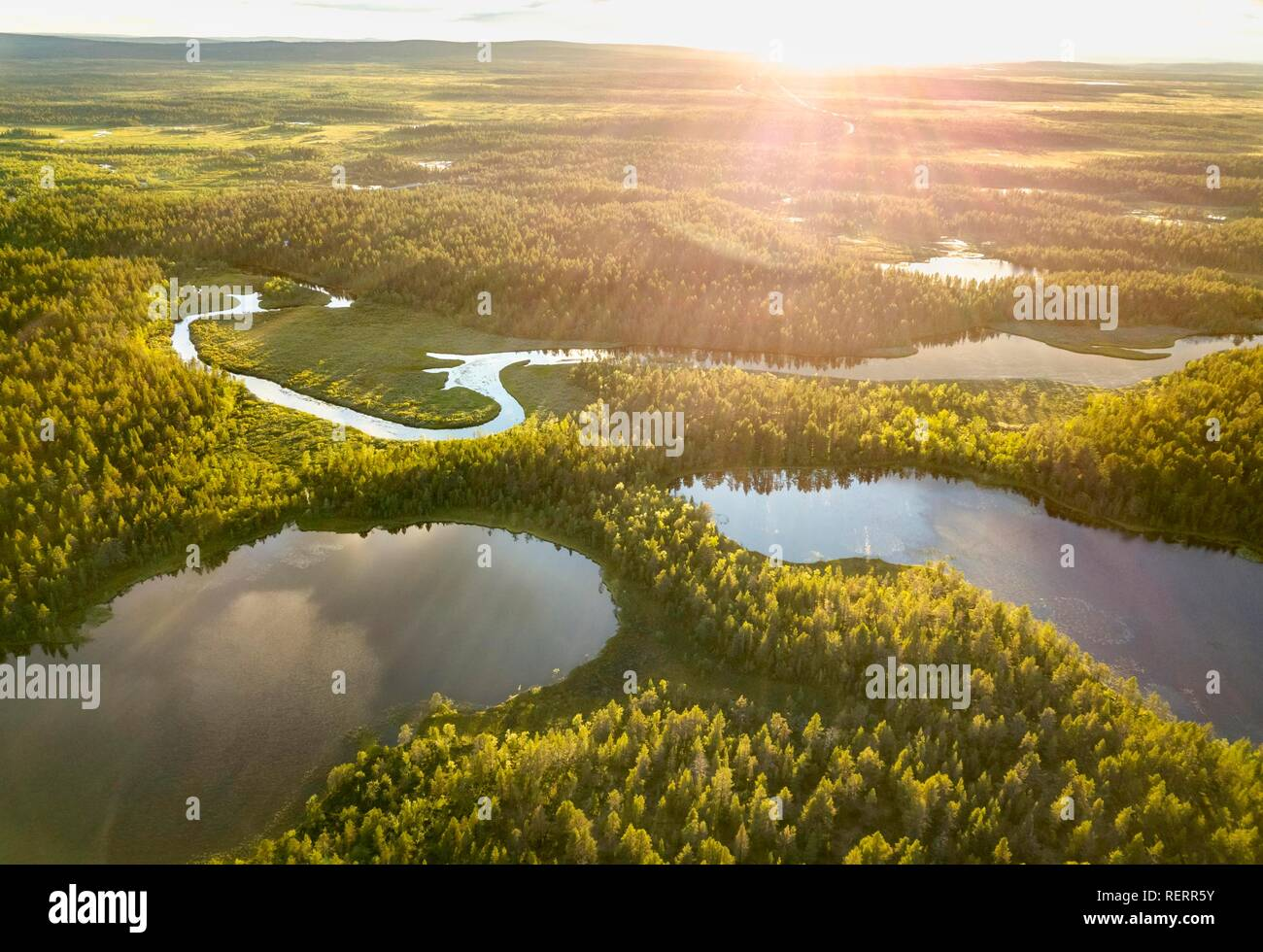 Drone view, aerial photo of Vuontisjärvi in backlight, small lakes and meanders, river loops in boreal arctic forest with - Stock Image