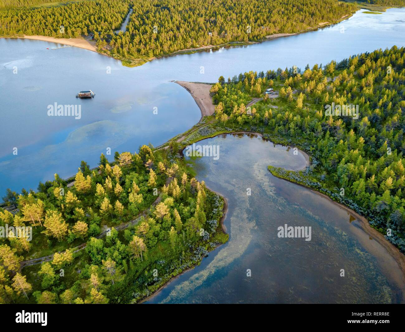 Drone view, aerial photo of floating house in Vuontisjärvi, lake in boreal arctic forest with conifers - Stock Image