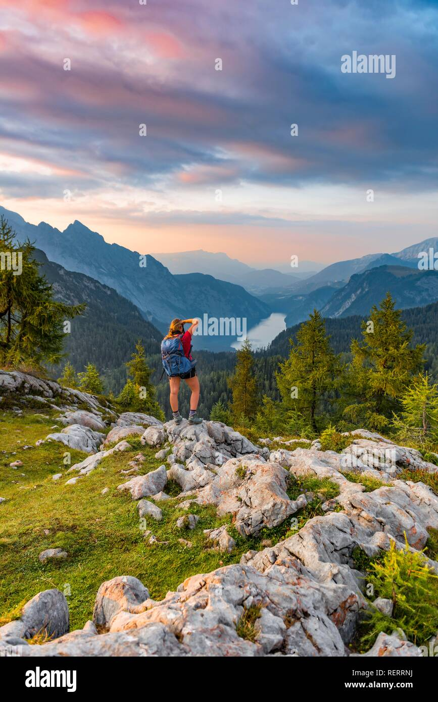 Hiker photographed, view over the Königssee from the Feldkogel, left Watzmann Südspitze and Watzmann-Kinder - Stock Image