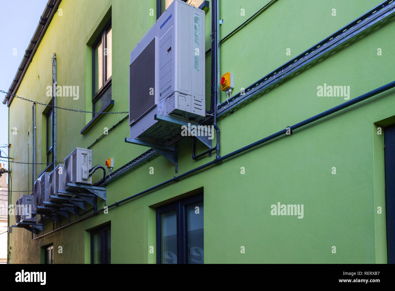Samsung digital inverter mounted on a wall - Stock Image