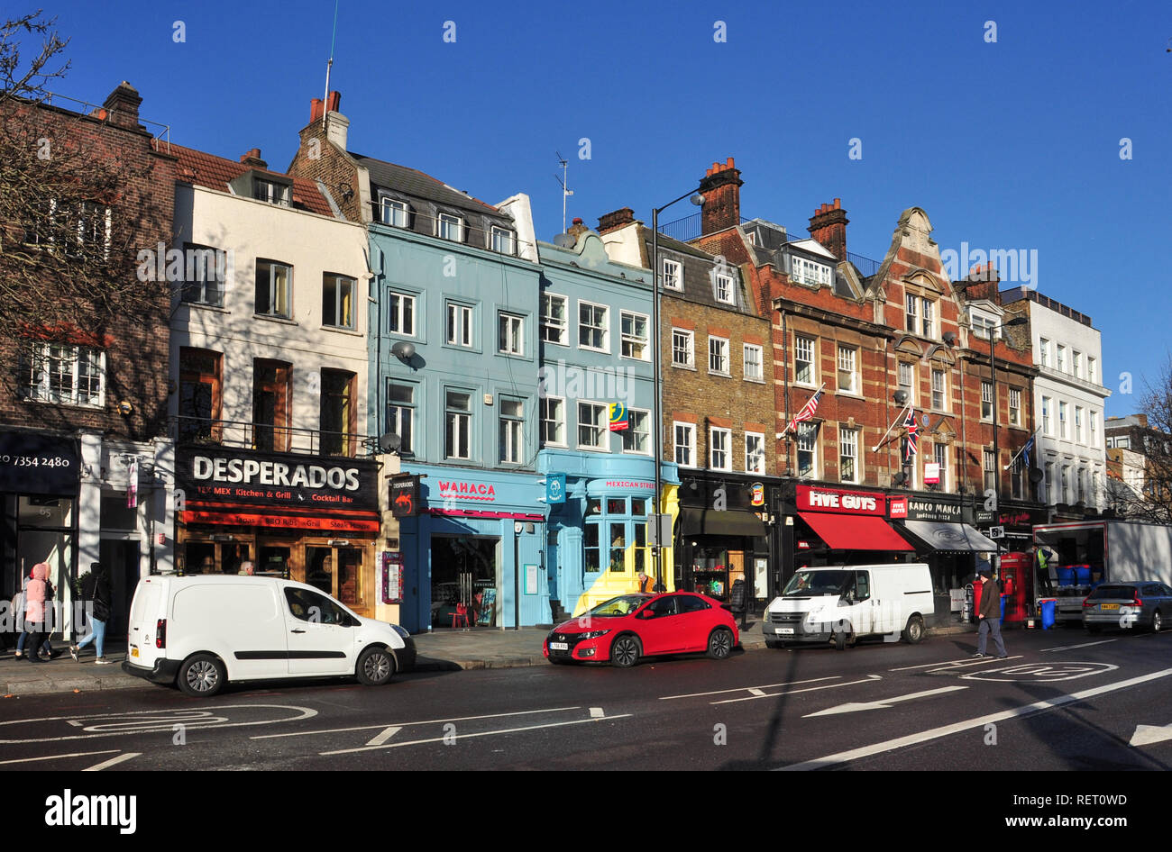Shops and Cafes, Upper Street, Islington, London, England, UK - Stock Image
