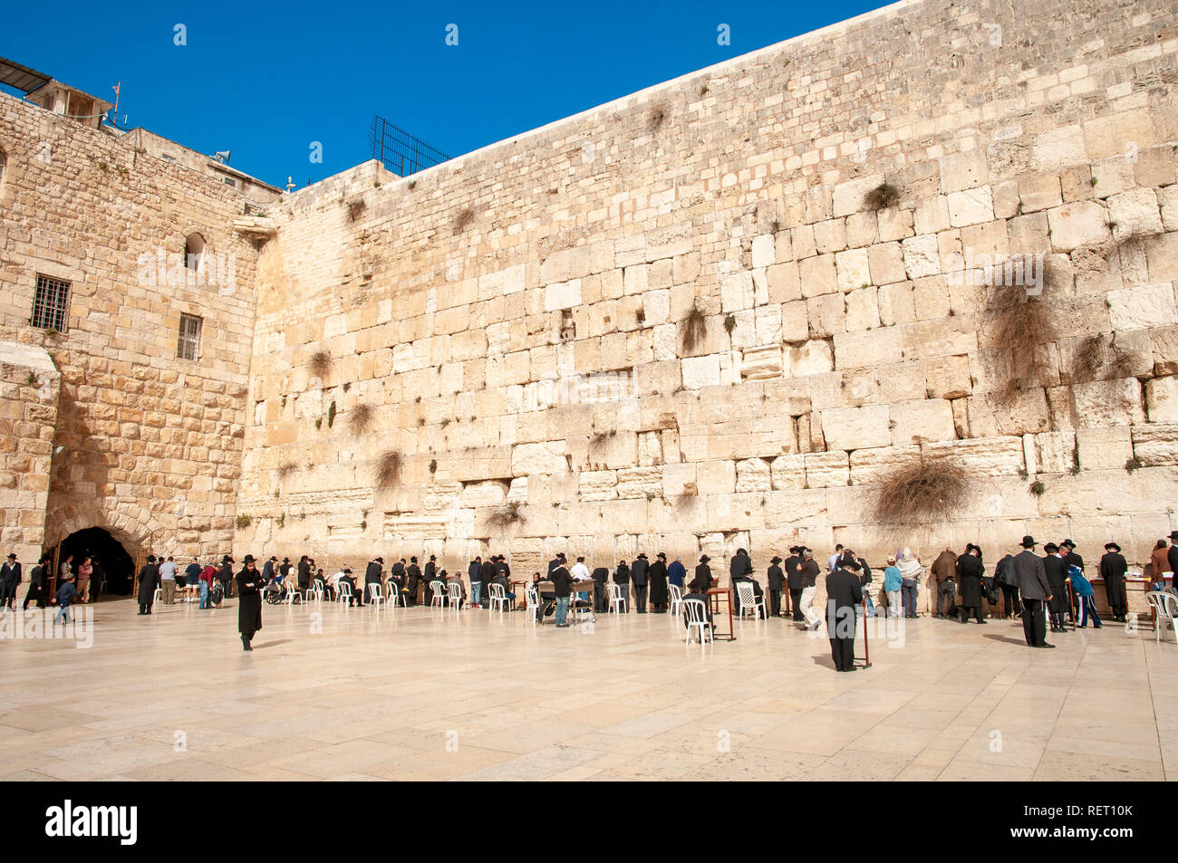 Orthodox Jews praying at the Western Wall, Jerusalem, Israel - Stock Image