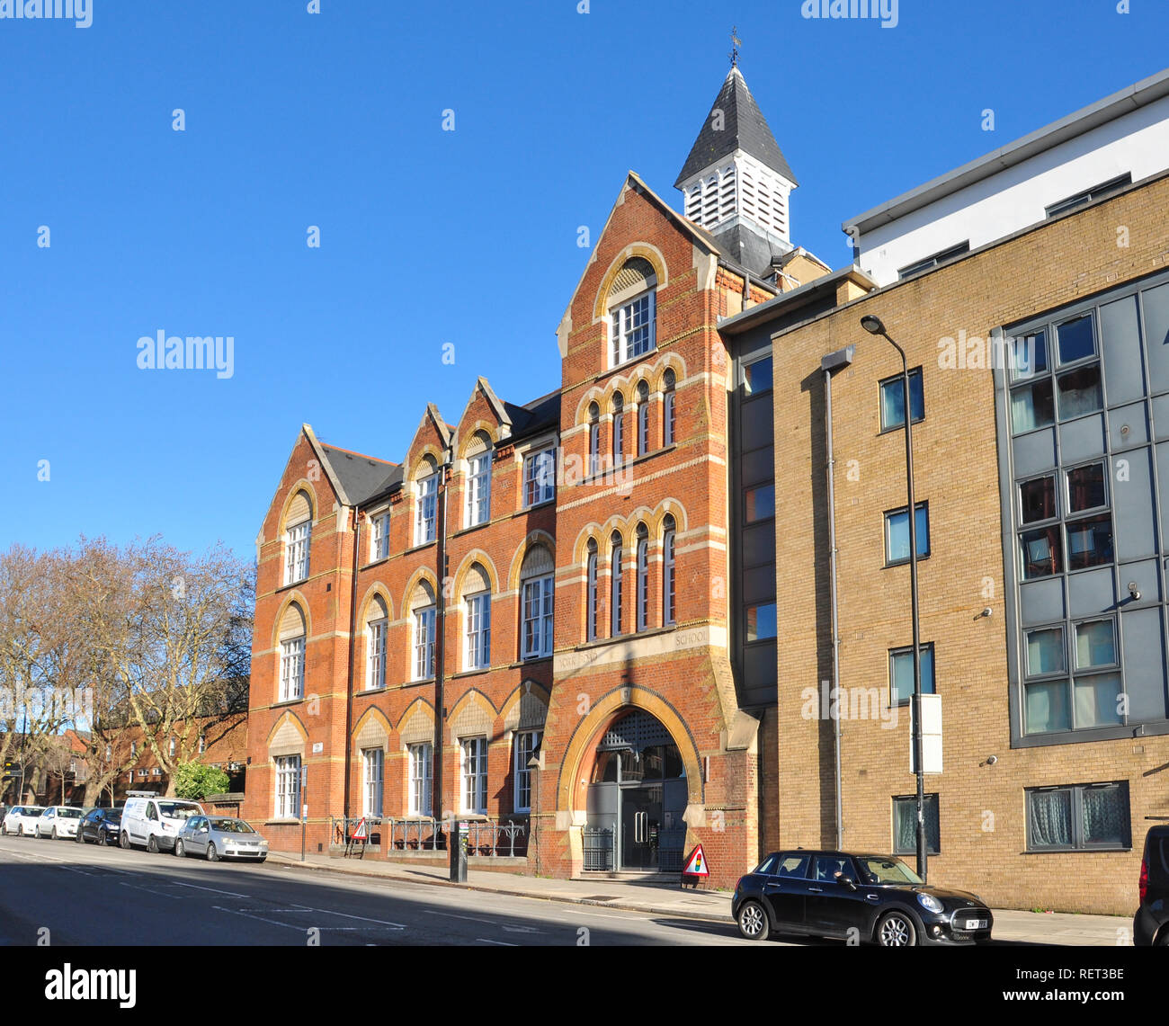 Refurbished old school building (formerly York Road School), York Way, King's Cross, London, England, UK - Stock Image