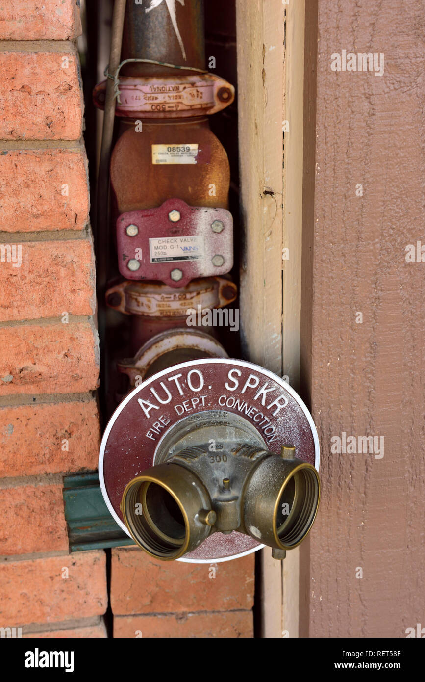 Fire hose standpipe dry risers main on outside building for firefighting sprinkler system - Stock Image
