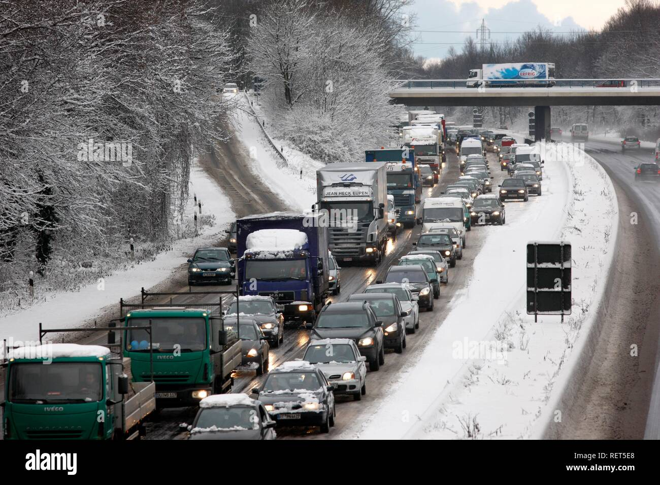 Traffic jam after heavy snow fall, motorway Autobahn A40, Ruhr expressway between Duisburg and Essen, near Muelheim - Stock Image
