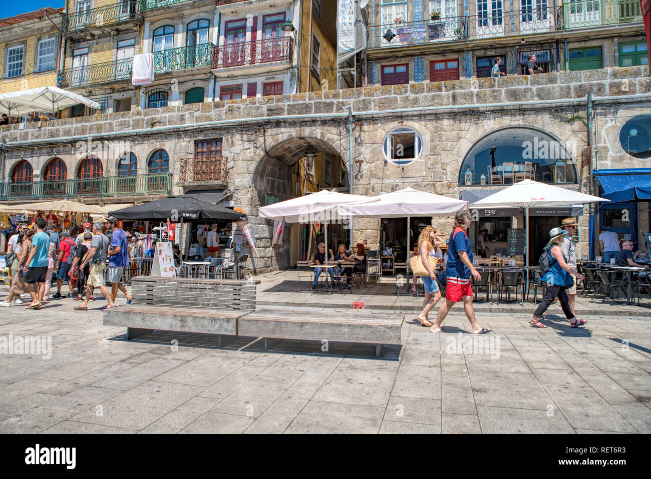 people at street restaurant on the embankment of Porto. Porto historical core was proclaimed a World Heritage Site - Stock Image