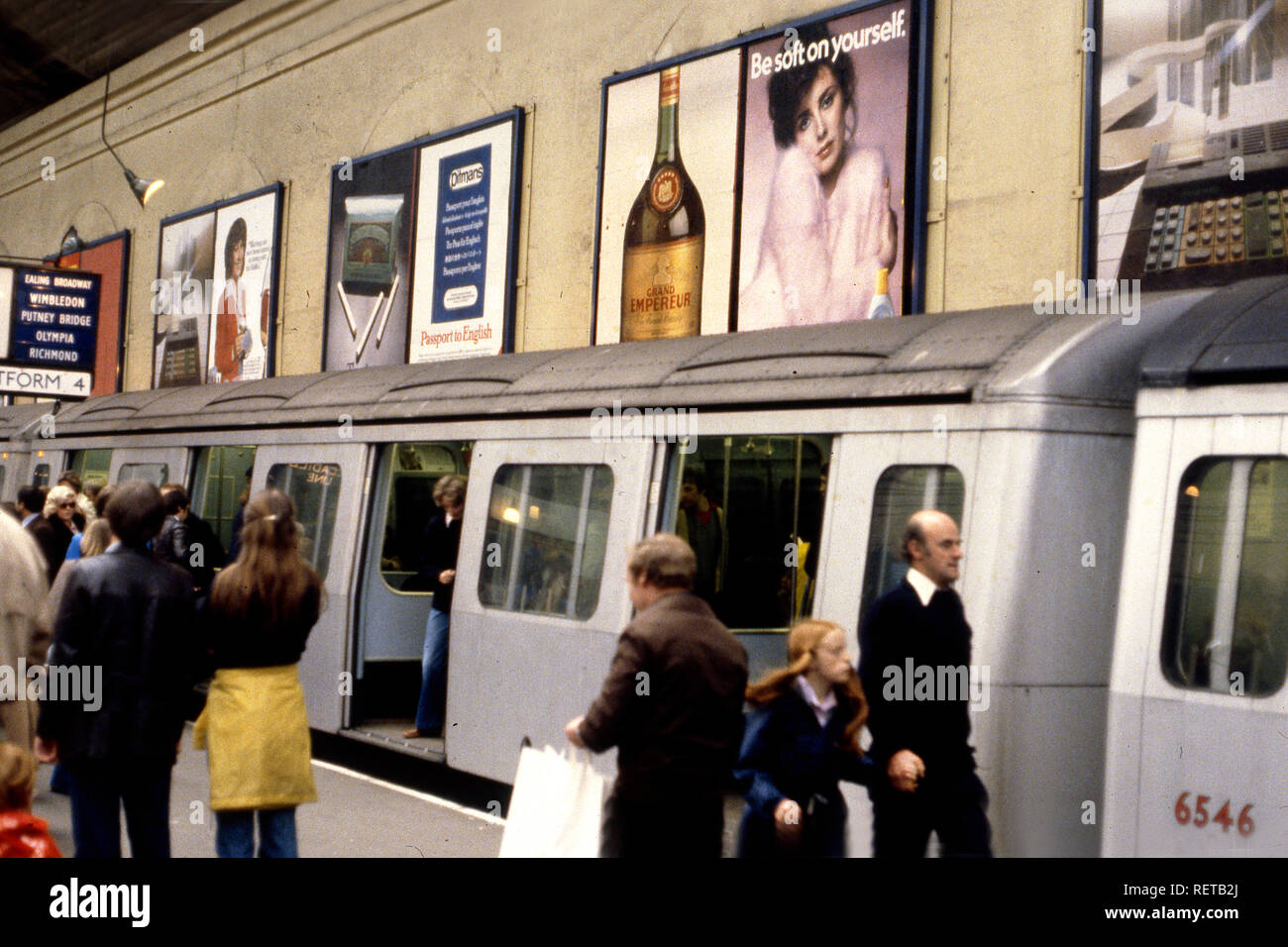 Subway with advertising posters in London circa 1970s - Stock Image