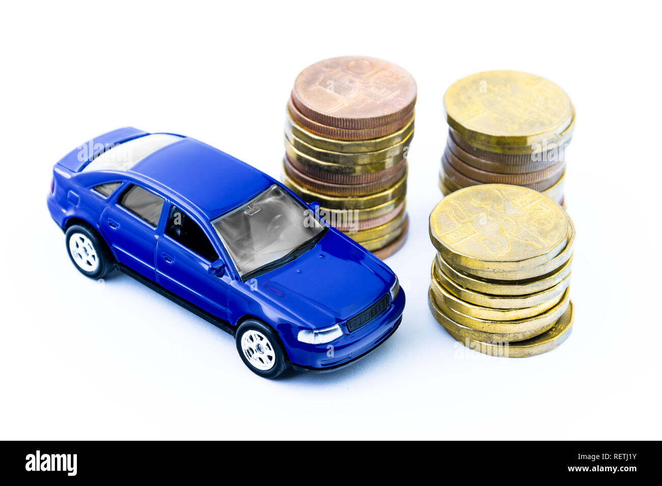 Model of blue car and coins on a white background. Isolated toy car and money. Financial concept. Buy a new or old car. - Stock Image