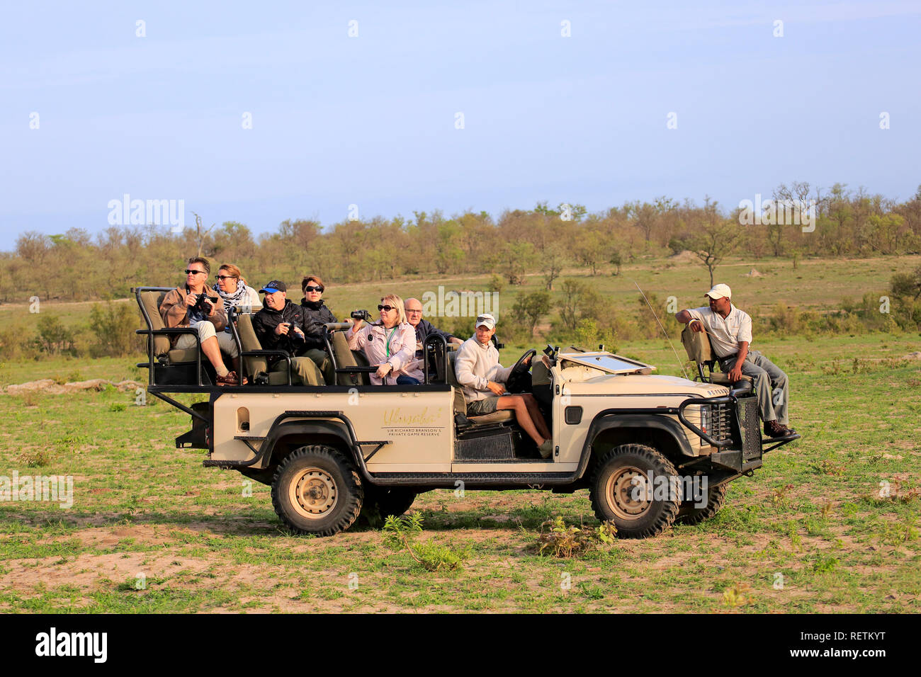 Safari vehicle, Private Game drive with tourists in Safari Vehicle, Sabi Sand Game Reserve, Kruger Nationalpark,South Africa, Africa - Stock Image