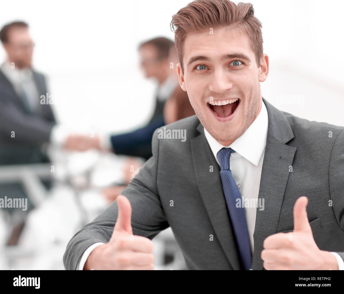 happy businessman showing thumbs up - Stock Image