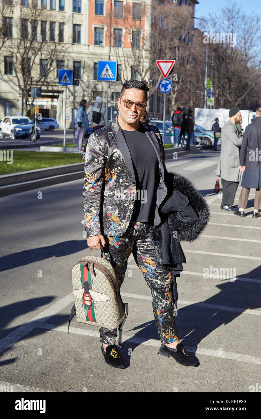 87423ffea1a MILAN, ITALY - JANUARY 14, 2019  Man with Gucci backpack and black satin