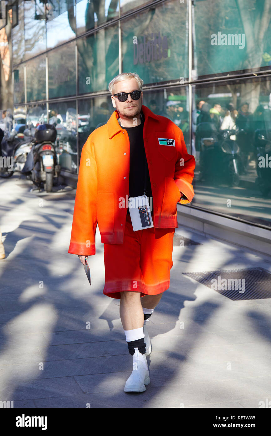 4cb36389a41 MILAN, ITALY - JANUARY 14, 2019  Man with orange Prada jacket and trousers