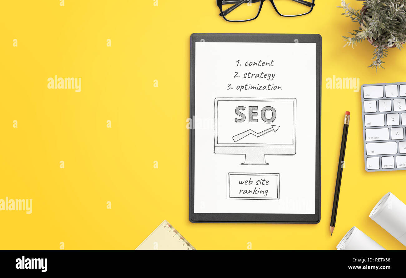 Search engine optimization goals sketch on paper. Office desk with copy space beside. Hero, header image. - Stock Image