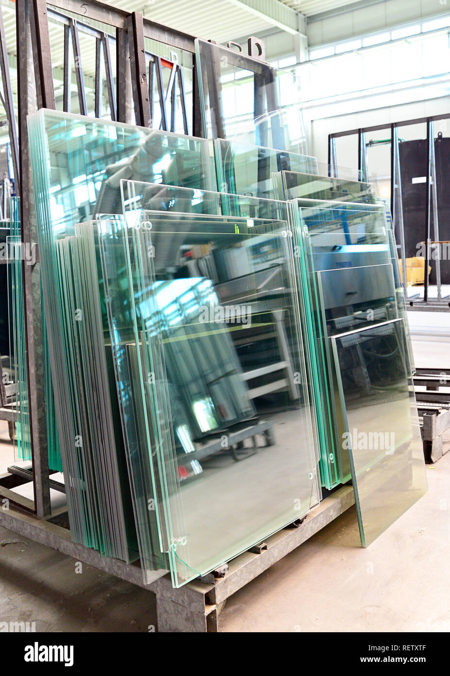 storage of finished glass panes for sale for house construction in a glassworks - Stock Image