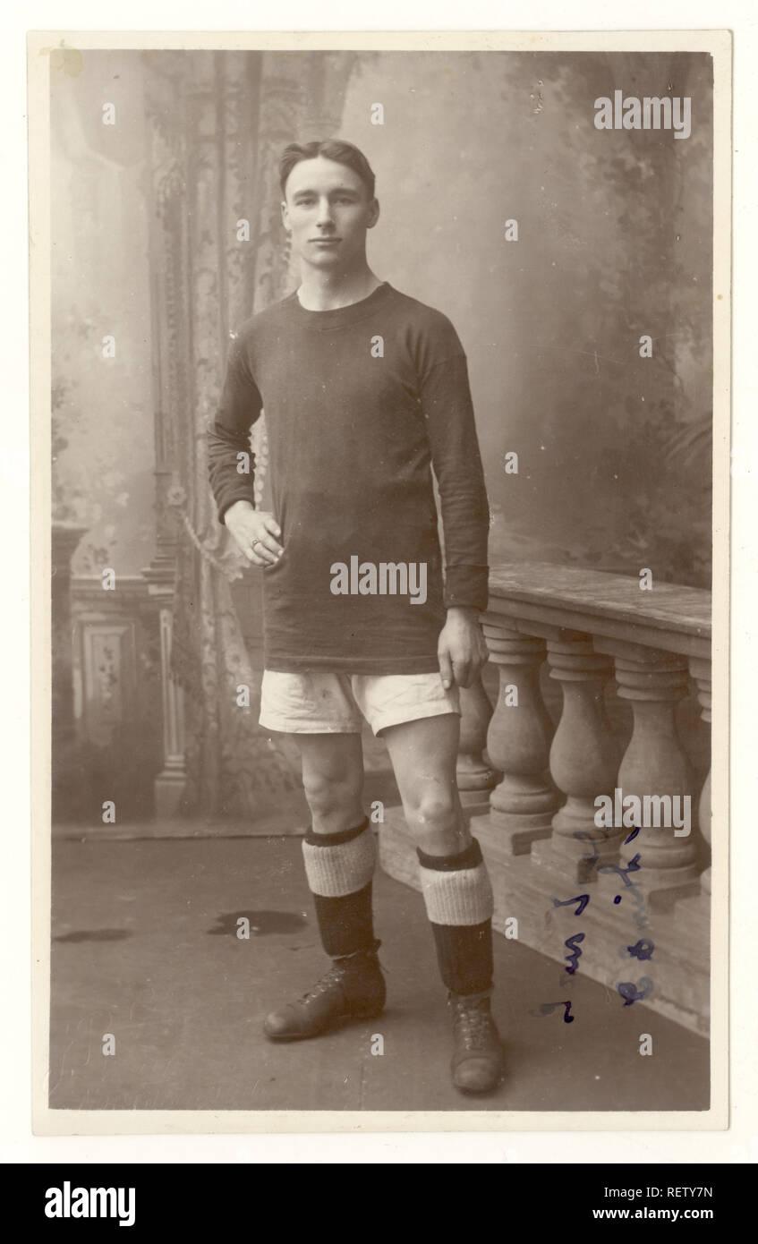Early 1900's studio portrait postcard of footballer, or rugby player, Northampton, U.K. circa , 1915 - Stock Image