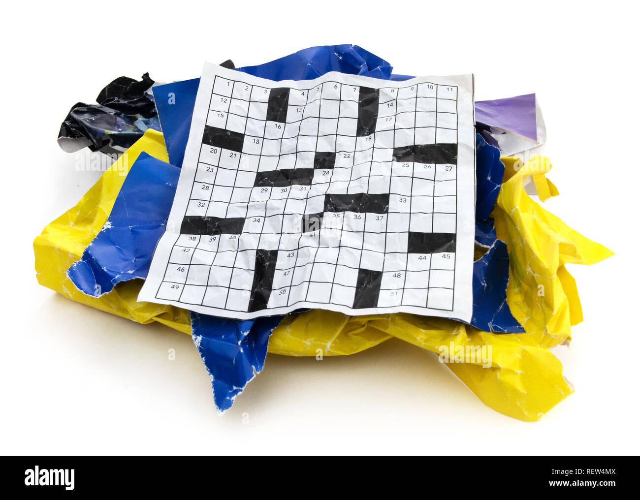 Isolated Crumpled torn ripped crossword puzzle paper cut out. Frustrated old wrinkled crumpled crossword puzzle paper on a white background. - Stock Image
