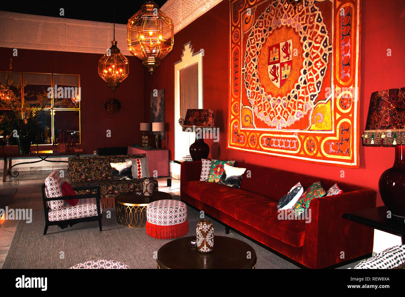 Old classical spanish interior with big red velvet sofa, different ...