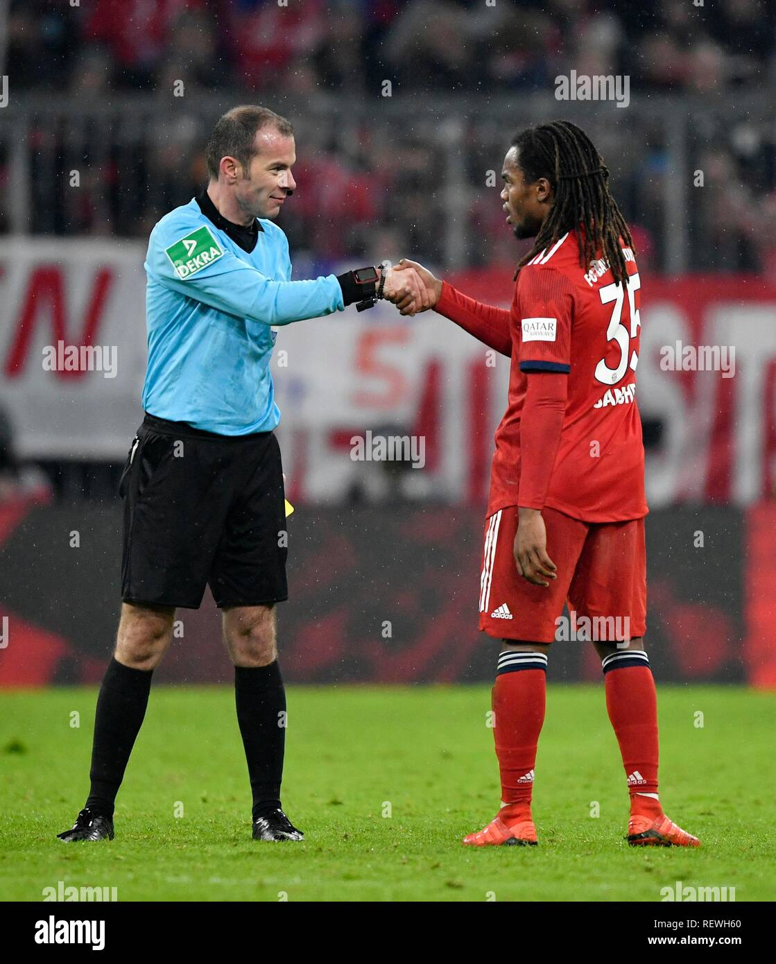 Fairplay Renato Sanches FC Bayern Munich and referee Marco Fritz shake hands for yellow-red card, Allianz Arena, Munich, Bavaria - Stock Image