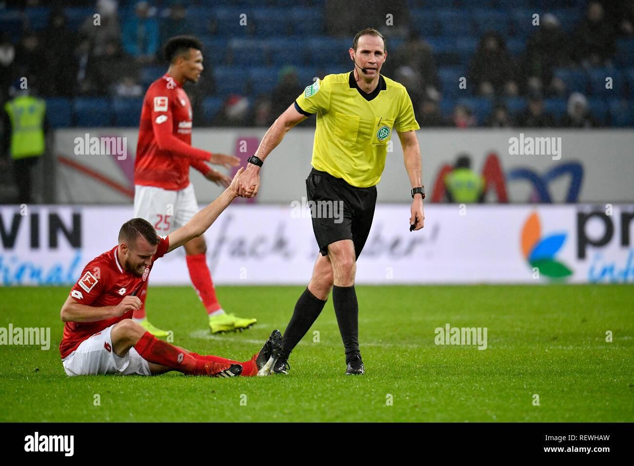 Referee Sascha Stegemann helps Daniel Brosinski 1st FSV Mainz 05 on his feet, Fairplay, Wirsol Rhein-Neckar-Arena, Sinsheim - Stock Image