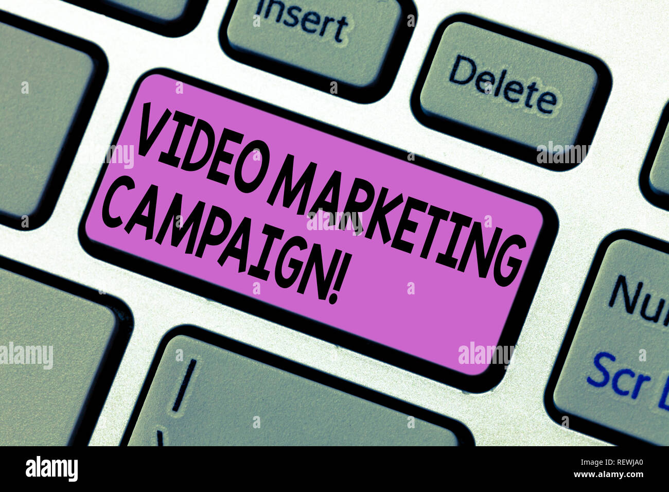 Handwriting text writing Video Marketing Campaign. Concept meaning Assessing the benefit of digital campaign Keyboard key Intention to create computer - Stock Image