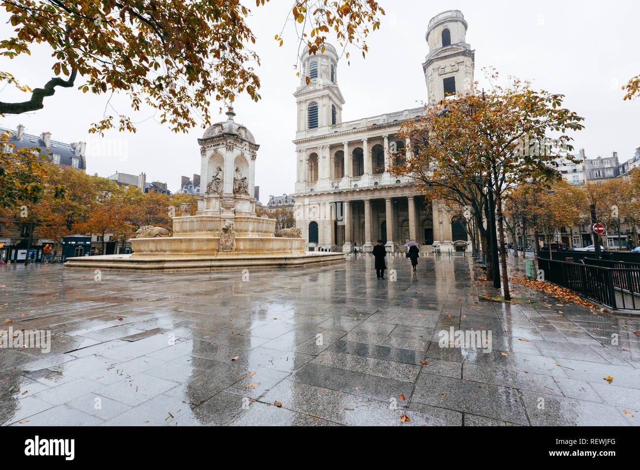 Paris (France) - Fountain Quatre Points Cardinaux and church of Saint-Sulpice Stock Photo